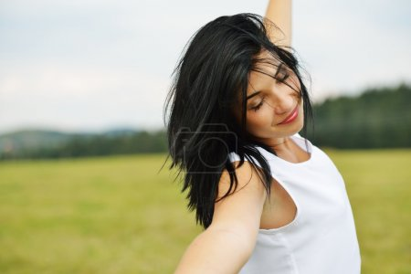 Photo for Young person having relaxed happy time on meadow in nature - Royalty Free Image
