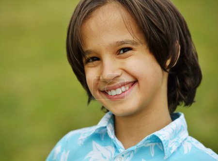 Happy kid on summer meadow