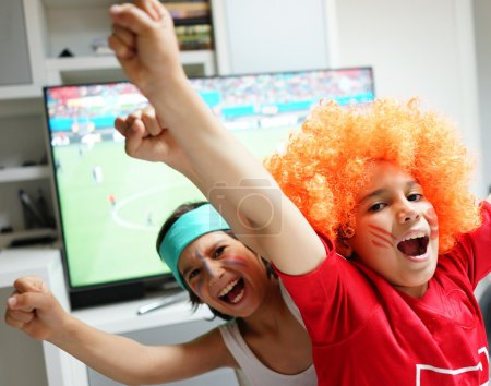 Kids watching football world cup game on tv