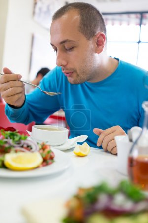 Photo for Man order food and eating lunch at restaurant - Royalty Free Image