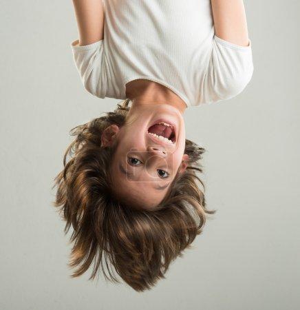 Little boy hanging upside down