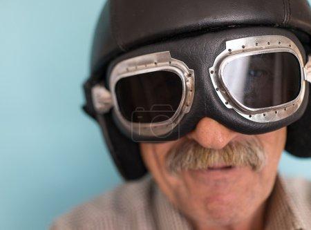 Senior funny man as a pilot