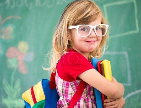 Cute little blonde school girl