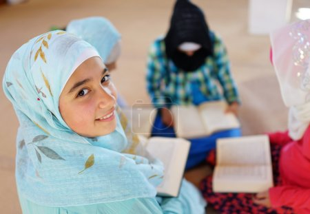 Muslim Arabic kids reading Koran at Mosque