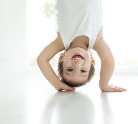 Happy little child upside down