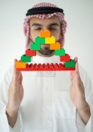 Portrait of attractive Arab building constructor