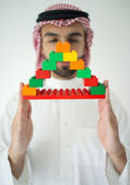 Portrait of attractive Arab building constructor