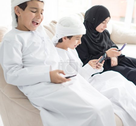 Happy Arabic family having fun at home