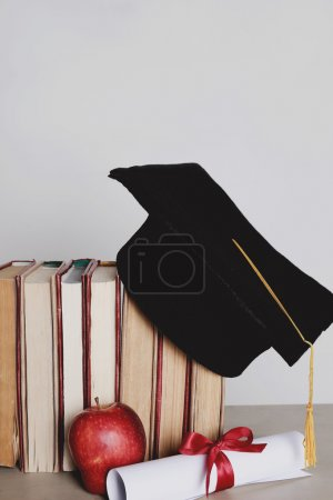 Photo for Graduation. Square academic hat with books - Royalty Free Image