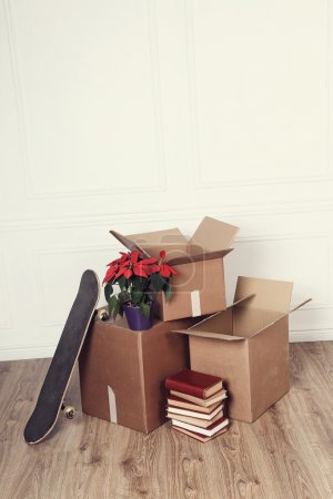 Photo for Moving home. Cardboard boxes on the floor - Royalty Free Image