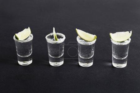 Vodka shots on black