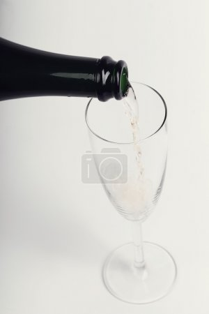 Photo for Alcoholic drink. Champagne pouring at party - Royalty Free Image