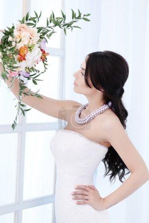 Lovely bride in wedding dress