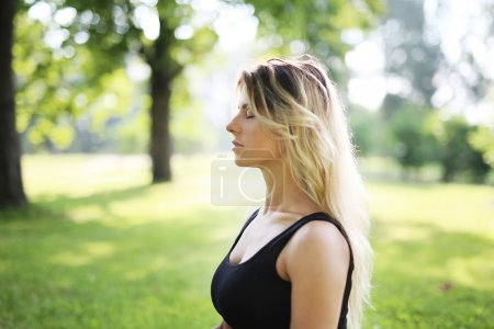 Woman practicing outdoor meditation