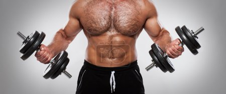 Fitness. Man with dumbbells