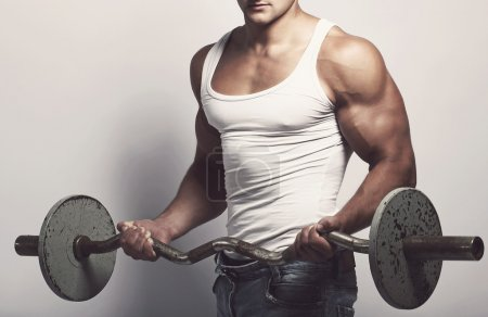 Handsome man with barbell