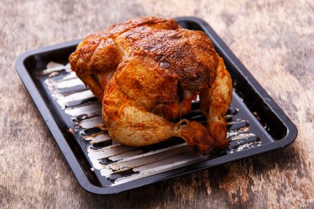Grilled chicken on wooden table