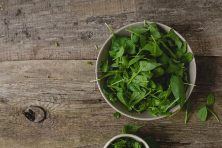 Spinach on wooden table
