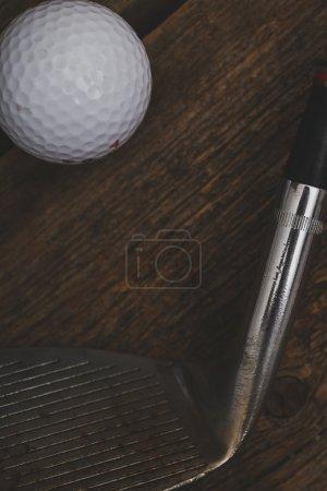 Golf ball near golf putter