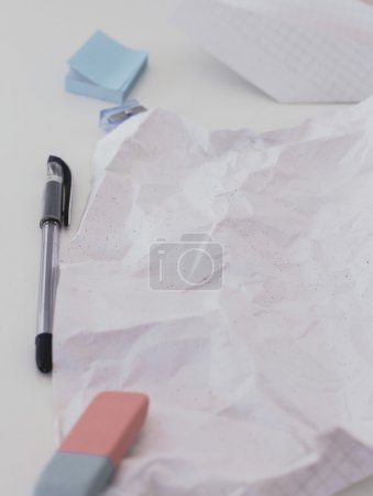Crumpled sheed of paper on the table