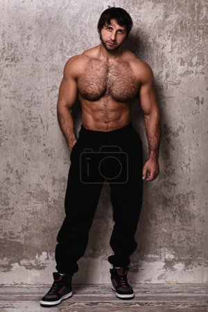 Shirtless bodybuilder with hairy chest
