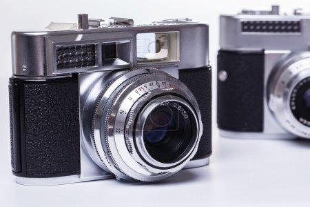 Retro cameras on a white