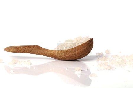 Heap of sea salt in spoon