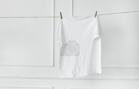 White t-shirt hanging by the wall