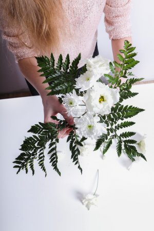 Woman making a flower bouquet