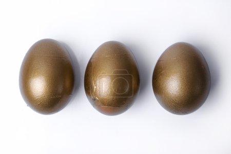 Golden eggs in row
