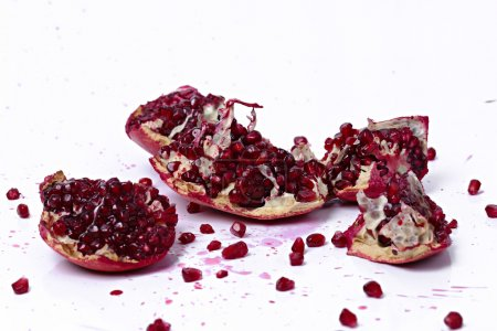 Juicy pomegranate on a white