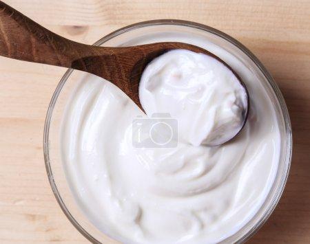 Greek yoghurt in bowl with spoon