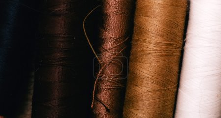 Spools of thread on a black