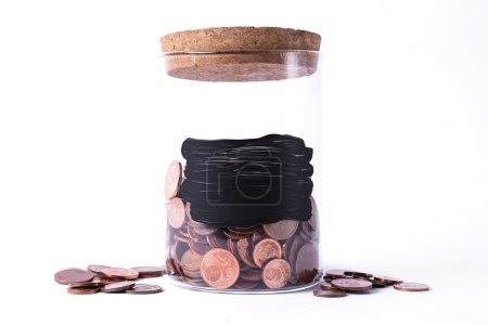 Jar with coins on white
