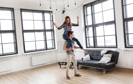 Woman on shoulders her man at home