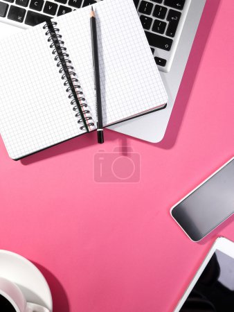 Photo for Workplace with laptop, notepad and coffee cup on table - Royalty Free Image