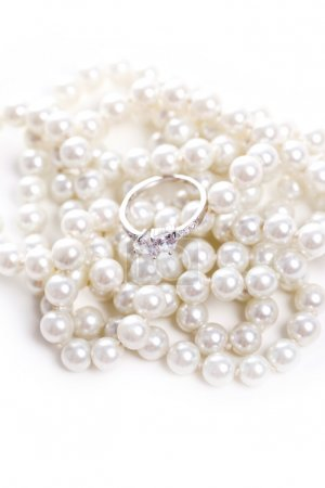 Ring with diamond and pearl necklace