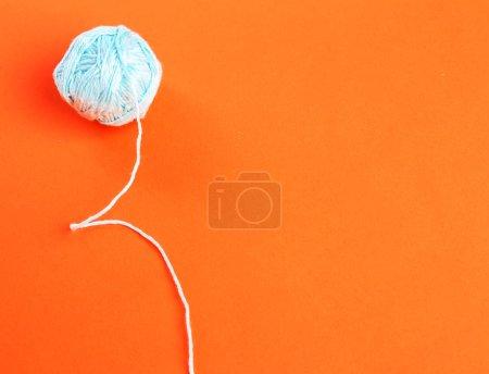 Threads on a orange background