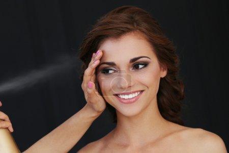 Beautiful bride during make-up