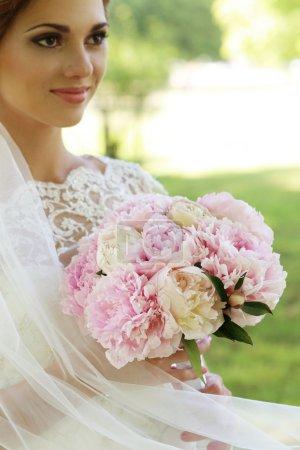Beautiful bride in park