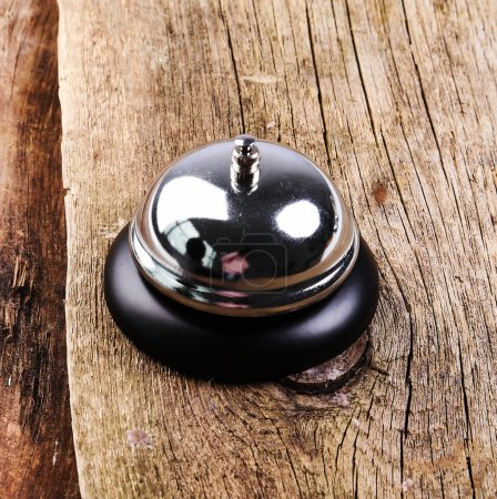 metallic Ring bell on table