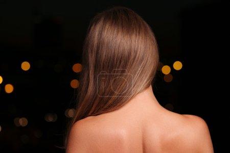 woman turned back