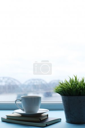 Coffee cup by window