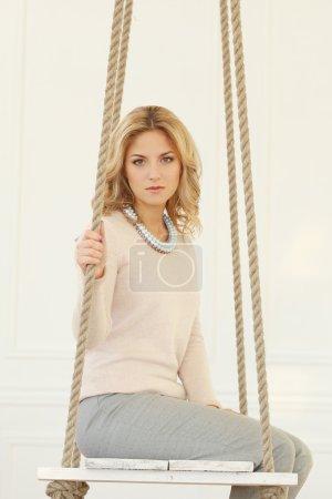 Blonde Woman on swing