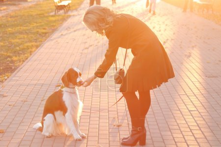 blonde woman with dog