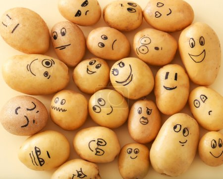 Photo for Funny faces potatoes  on a yellow background - Royalty Free Image