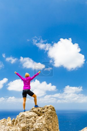 Photo for Success achievement running or hiking accomplishment or business concept, woman celebrating with arms up raised outstretched trekking climbing trail running outdoors. Motivation and inspiration looking at beautiful landscape view. - Royalty Free Image
