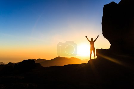 Photo for Woman successful hiking climbing silhouette in mountains, motivation and inspiration in beautiful sunset and ocean. Female hiker with arms up outstretched on mountain top looking at beautiful night sunset inspirational landscape. - Royalty Free Image