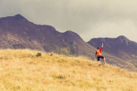 Photo for Hiking man and success in mountains. Fitness and healthy lifestyle outdoors in summer nature - Royalty Free Image