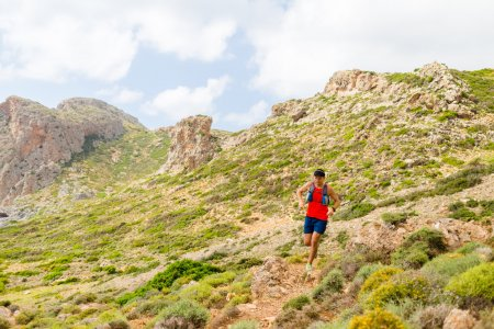 Trail running man in inspirational mountains